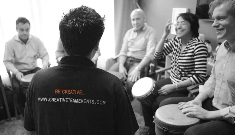 Team building drumming activity with a small team