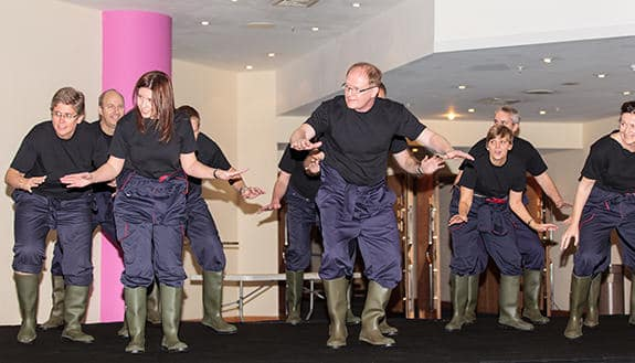 Leaders performing gum boot dancing